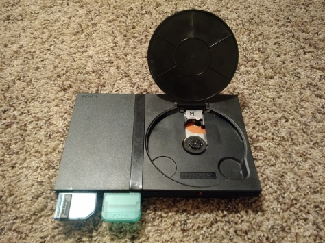"My modified PS2, featuring a ""toilet seat"" disc cover."